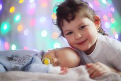 Newborn baby and sister Royalty Free Stock Images