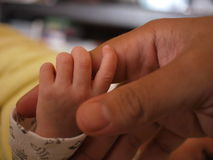 A newborn baby holding his father hand Royalty Free Stock Image