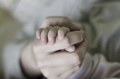 Newborn baby holding his mothers hand Stock Photo