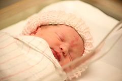 Newborn baby in hospital asleep in blanket Royalty Free Stock Photography
