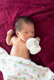 Newborn baby infant eating milk from bottle. Stock Photos