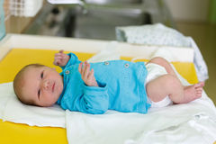 Newborn baby infant in the hospital. The first hours of the new life, one days after birth Stock Images