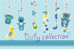 Newborn baby items hanging on rope.Baby boy collection. Colorful  baby items for newborn baby boy hanging on the rope on polka dot background. Design template Royalty Free Stock Photo