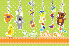 Newborn baby items hanging on the rope.Baby fashion set. Colorful  baby items for newborn baby boy and girl hanging on the rope on polka dot background. Design Royalty Free Stock Image