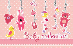 Newborn baby items hanging on rope.Baby girl collection Stock Photos