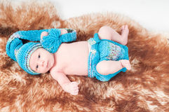 Newborn baby in knitted blue clothes Royalty Free Stock Images