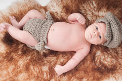 Newborn baby in knitted blue clothes Stock Photo
