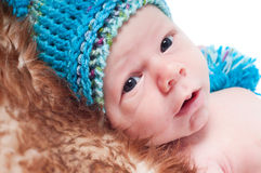 Newborn baby in knitted blue hat Royalty Free Stock Images