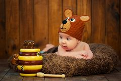 Newborn baby in a knitted cap bears. Royalty Free Stock Photos