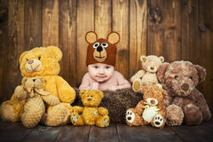 Newborn baby in a knitted cap bears. Royalty Free Stock Image