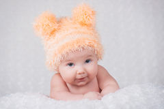 Newborn baby in a knitted cap with ears. Stock Image