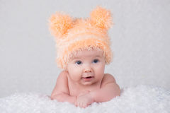 Newborn baby in a knitted cap with ears. Royalty Free Stock Images