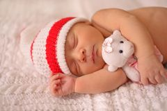 A newborn baby sleeps sweetly. royalty free stock images
