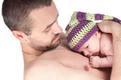 Newborn baby in knitted hat with dad Royalty Free Stock Image