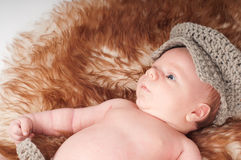 Newborn baby in knitted hat Royalty Free Stock Images