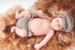 Newborn baby in knitted wear Stock Image