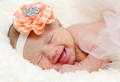 Newborn baby laughing Stock Photos
