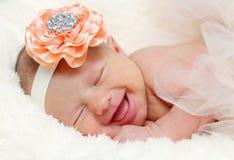 Newborn baby laughing. Newborn sleeping baby girl laughing and smiling stock photos