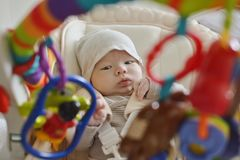 Newborn  baby  in bouncer chair Stock Photos