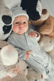 Newborn baby laying with five teddy bears on blanket Stock Photo