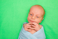 Newborn Baby laying on green cover Royalty Free Stock Photo