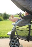Newborn Baby legs and Feet Hanging out of Stroller Royalty Free Stock Photo