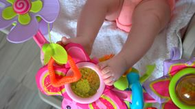 Newborn baby legs and toys. stock footage