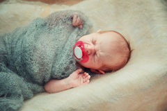 Newborn baby lies in a crib. Royalty Free Stock Photography