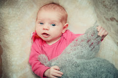 Newborn baby lies in a crib. Stock Photography