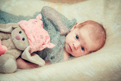 Newborn baby lies in a crib. Royalty Free Stock Images