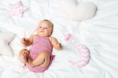 Newborn baby. Little newborn baby with pillows on white bed Royalty Free Stock Photos