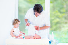 Newborn baby looking at his father and toddler sister Royalty Free Stock Photography