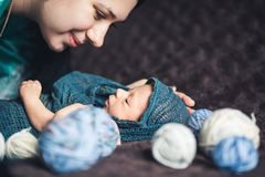 Newborn baby looks at her mother. Beautiful concept of motherhood stock photos