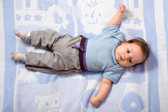 Newborn baby lying on a bed Royalty Free Stock Images