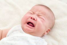 Newborn baby lying in bed Stock Image