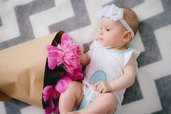 Newborn baby explore the world and playing with flowers Stock Image