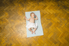Newborn baby lying on the blanket. Beautiful newborn baby lying on the blanket Royalty Free Stock Images