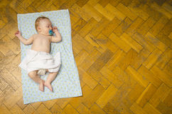 Newborn baby lying on the blanket. Beautiful newborn baby lying on the blanket Stock Photography