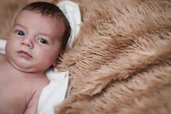 Newborn baby lying on the blanket. And sleeping Stock Image