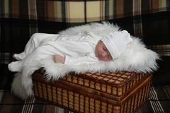 Newborn baby lying on the blanket. And sleeping Royalty Free Stock Images