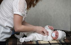 Newborn baby lying on the blanket. And sleeping Royalty Free Stock Photos