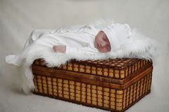 Newborn baby lying on the blanket. And sleeping Stock Images