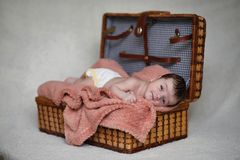 Newborn baby lying on the blanket. And sleeping Royalty Free Stock Photography