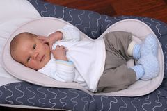 Newborn baby lying in bouncer chair Royalty Free Stock Photo