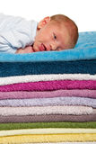 Newborn baby lying on colorful towels Royalty Free Stock Images
