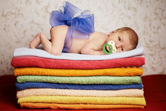 Newborn baby lying on colorful towels Royalty Free Stock Photography