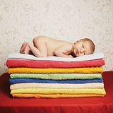 Newborn baby lying on colorful towels Royalty Free Stock Photo
