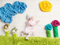 Newborn baby lying on creative clothing Royalty Free Stock Photos