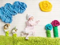 Newborn baby lying on creative clothing Royalty Free Stock Photos