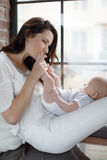 Newborn baby lying on his mother`s lap Royalty Free Stock Photo